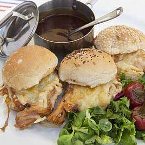 Pulled Pork Sliders Garnished with Cheese